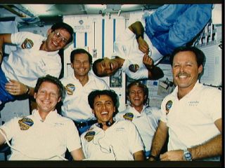 In-flight portrait of STS 61-C crew. Astronaut Robert L. Gibson (lower right corner), mission commander, is surrounded by fellow crewmembers, counter-clockwise from upper right: Astronaut Charles F. Bolden, pilot; U.S. Representative Bill Nelson (D.-Flori