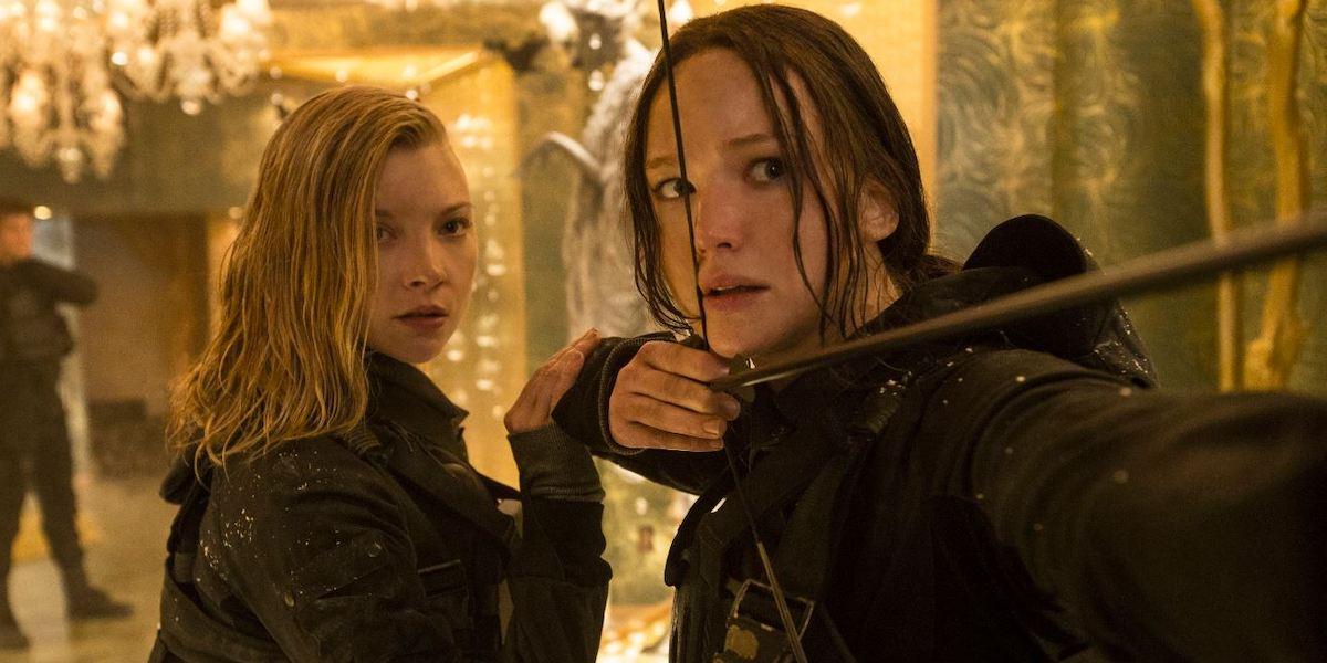 Natalie Dormer and Jennifer Lawrence in Hunger Games: Mockingjay