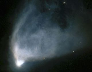 """A strange """"faster-than-light"""" experiment could help astronomers study distant objects like NGC 2261, a fan-shaped cloud of gas and dust that is illuminated by a star at its base."""