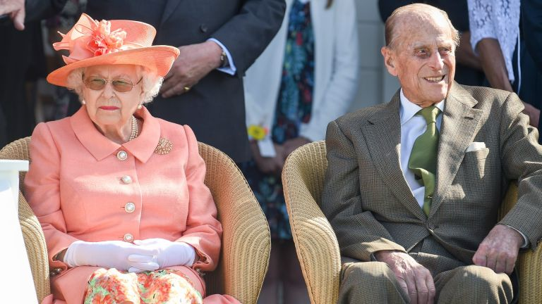 Queen Elizabeth II and Prince Philip, Duke of Edinburgh attend The OUT-SOURCING Inc Royal Windsor Cup 2018 polo match at Guards Polo Club on June 24, 2018 in Egham
