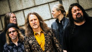 Hasse Froberg & Musical Companion group shot with gold and black jacket