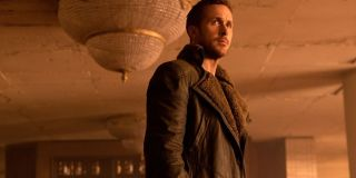 Blade Runner 2049 Ryan Gosling standing in a crumbling ballroom