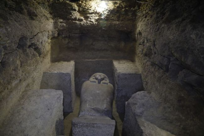 The face of one of the stone sarcophagi discovered in the burial ground.