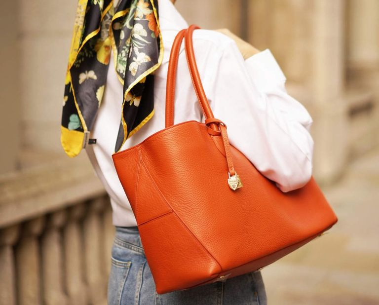 woman carrying Aspinal bag