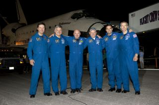 The crew of STS-134 pose for a photo on the Shuttle Landing Facility at NASA's Kennedy Space Center in Florida following the landing of space shuttle Endeavour. (L to R) European Space Agency's Roberto Vittori, Pilot Greg H. Johnson, Commander Mark Kelly,