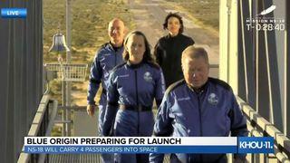 William Shatner leads astronauts and Amazon founder Jeff Bezos to Blue Origin's New Shepard spacecraft.