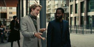 Tenet Robert Pattinson and John David Washington talking as they walk outside