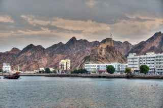 View or the Corniche and Mutrah fort in Muscat, Oman.
