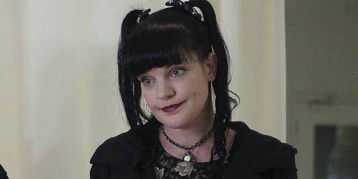Pauley Perrette looking a bit somber as she stands on NCIS, wearing all black.