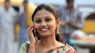 Woman using a mobile phone in India.