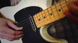 Man chicken pickin' on his Fender Telecaster