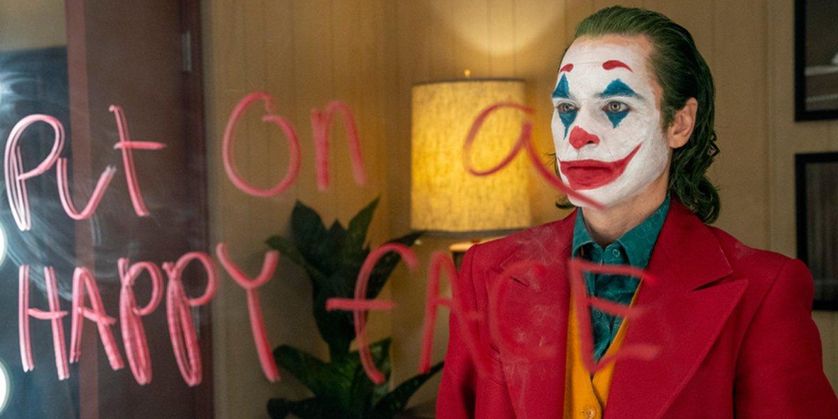 Joker Joaquin Phoenix Put On A Happy Face written on mirror DC Warner Bros.