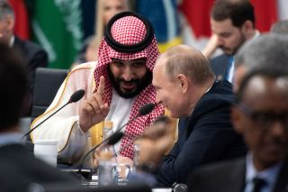 Saudi Crown Prince Mohammad bin Salman speaking with Russian President Vladimir Putin at a G20 summit in Buenos Aires, November 2018.