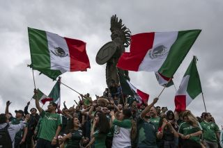 Mexico soccer fans celebrate big at the Cuauhtemoc monument in Tijuana, Baja California state, after a win against Germany in their first match of the 2018 World Cup.