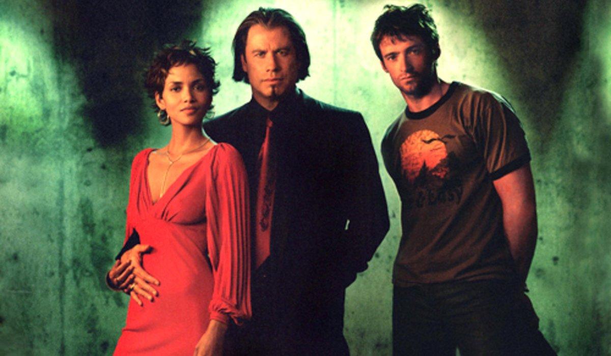 Halle Berry, John Travolta, and Hugh Jackman stand together in Swordfish.
