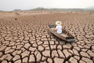 man in a bought on dry cracked ground