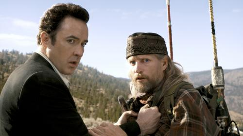 2012 - John Cusack's Jackson Curtis learns about impending disaster from Woody Harrelson's flaky Charlie Frost in Roland Emmerich's blockbuster movie