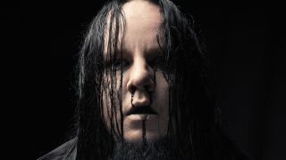 A portrait of Joey Jordison with black blood running from his nose