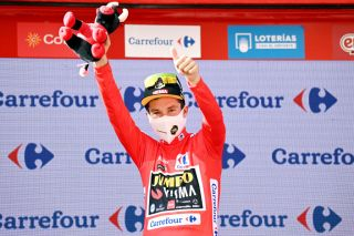 BURGOS SPAIN AUGUST 15 Primoz Roglic of Slovenia and Team Jumbo Visma celebrates winning the Red Leader Jersey on the podium ceremony after the 76th Tour of Spain 2021 Stage 2 a 1667km stage from Caleruega Monasterio de Santo Domingo de Guzmn to Burgos Gamonal lavuelta LaVuelta21 CapitalMundialdelCiclismo on August 15 2021 in Burgos Spain Photo by Stuart FranklinGetty Images
