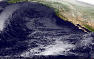 An image of the weather above the West Coast, taken by the NOAA GOES-15 satellite. Notice the lack of moisture over the Southwest, corresponding to cold, dry air.