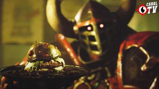 A Blood Bowl player holds a slimy burger