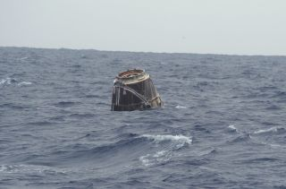 SpaceX's first Dragon capsule to visit the International Space Station bobs in the Pacific Ocean after a successful splashdown that capped its successful test flight on May 31, 2012.