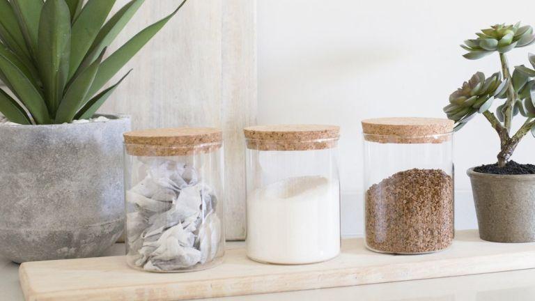 Mrs Hinch storage buys: Stockholm Storage Jars with cork lids in kitchen on wooden board