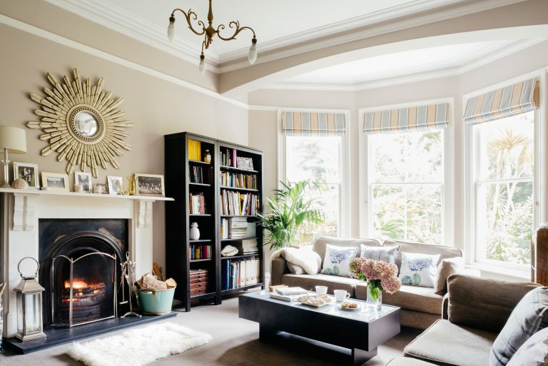 living room with fireplace and bookshelf in period home
