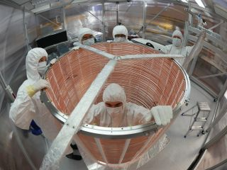 A team works on assembling the XENON1T dark matter experiment.