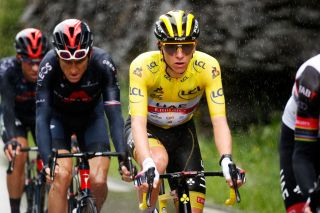 TIGNES FRANCE JULY 04 Tadej Pogacar of Slovenia and UAE Team Emirates yellow leader jersey during the 108th Tour de France 2021 Stage 9 a 1449km stage from Cluses to Tignes Monte de Tignes 2107m LeTour TDF2021 on July 04 2021 in Tignes France Photo by Chris GraythenGetty Images
