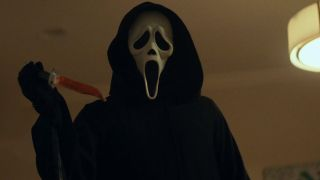 Ghostface with a bloody knife in Scream 2022