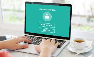 Laptop displaying text 'Enter password' and 'Log in'.