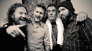 Mastodon standing together in a backstage room