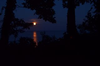 A full moon reflects on the Patuxent River in Maryland in 2013.