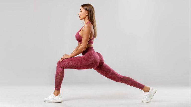 Woman dressed in exercise kit doing the booty workout challenge