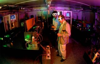 shooting laser beams at antimatter