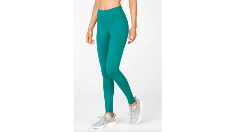 fabletics leggings review: model wearing Fabletics High-Waisted PowerHold Leggings