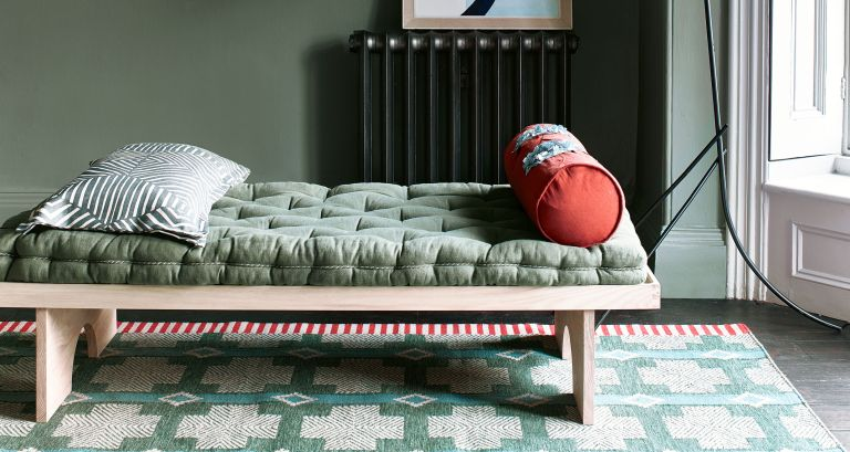 Green daybed in room for monochromatic color scheme