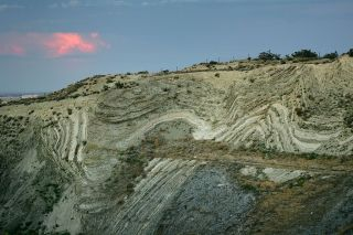 Layers of earthquake-twisted earth stand out where the freeway crosses the San Andreas Fault on June 28, 2006.