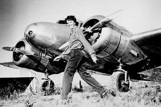 Amerlia Earhart, first woman flying across the ocean