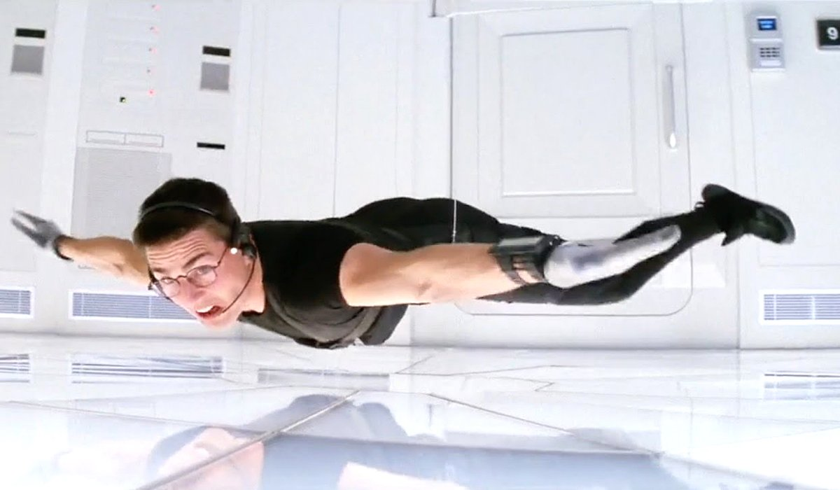 Mission: Impossible Ethan Hunt Tom Cruise almost touches floor