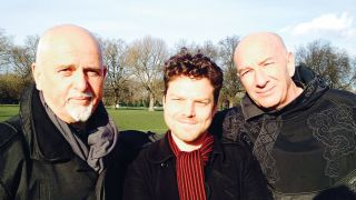 Peter Gabriel poses with Brian Pern actors and writers Rhys Thomas and Simon Day in a park