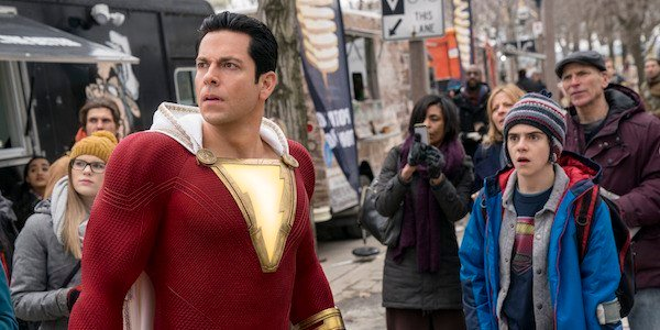 Shazam and Freddy looking in the distance at something concerning