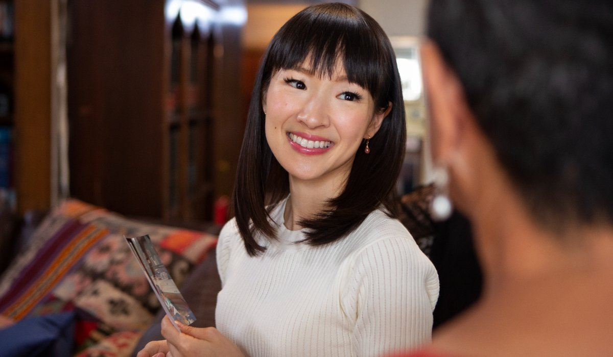 Marie Kondo smiles while working in Tidying Up with Marie Kondo.