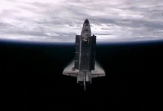 A video camera on the exterior of the International Space Station captured this image of space shuttle Endeavour a little less than an hour after the two spacecraft undocked at 11:55 p.m. ET May 29, 2011 during the STS-134 mission.