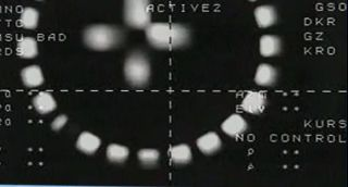 The European Space Agency's ATV-5 cargo vessel, known as Georges Lemaitre, leaves the International Space Station on Feb. 14, 2015. The station was in darkness at the time, explaining why this departure image snapped by ATV-5 is blurry.