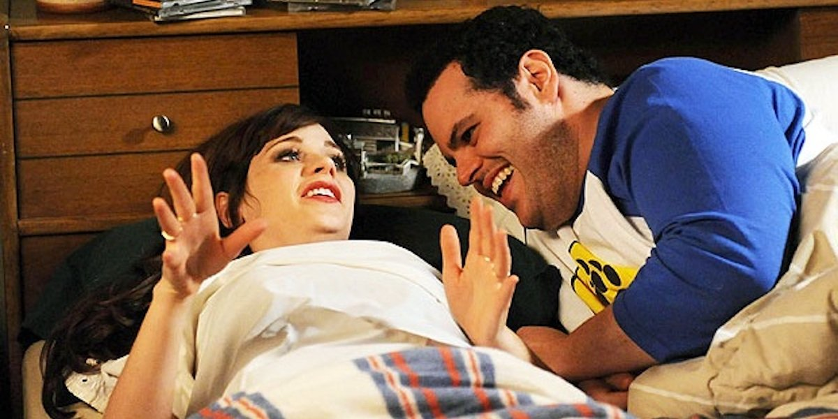 Zooey Deschanel and Josh Gad as Jess and Bearclaw in bed in New Girl