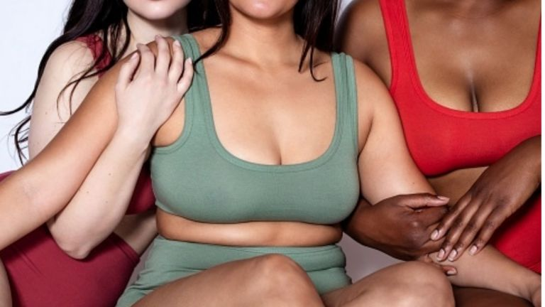 Women of different shapes and skin tones posing in underwear