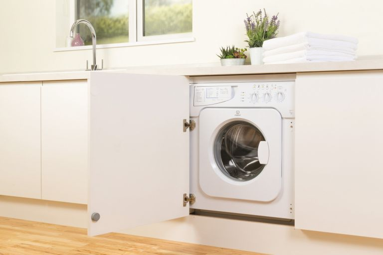 cheap washing machines such as this integrated one by Indesit in a kitchen