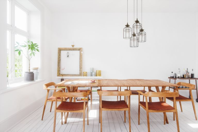 large wooden dining table in contemporary space